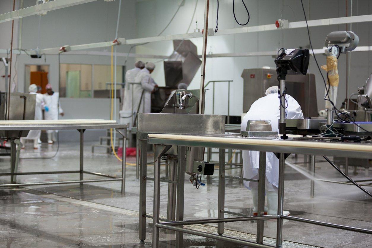 butcher cleaning floor